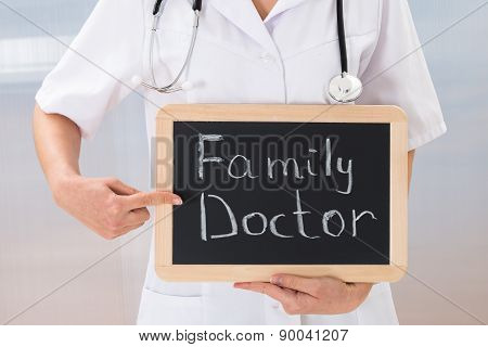 Female Doctor With Slate Chalkboard