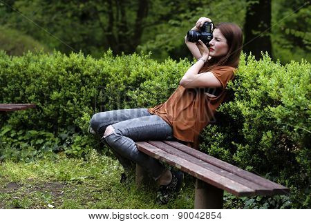Brunette girl taking nature photos