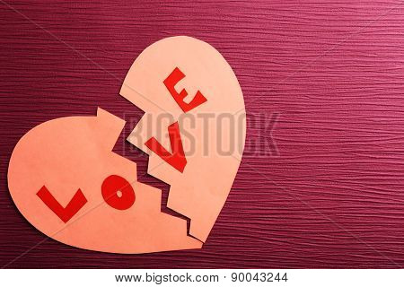 Broken heart on colour background