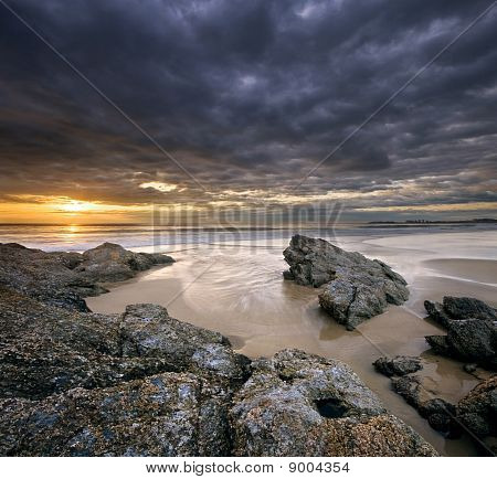 rocks on beach at sunrise