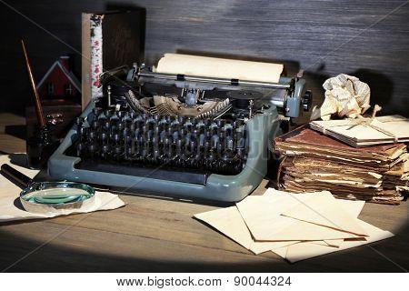 Retro typewriter on wooden background