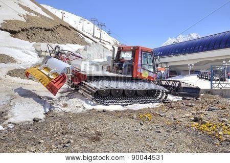Dombay. Snowcat On A Slope