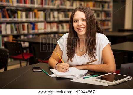 Happy Brunette Doing Homework