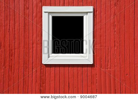 White Window on Red Wall of a Caboose
