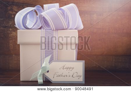 Happy Fathers Gift With Blue And White Gift On Wood Background.