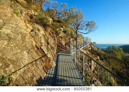 Metal Walkway Under Cliffs