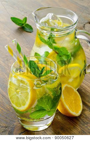 Cold tasty lemonade with fresh lemon and mint