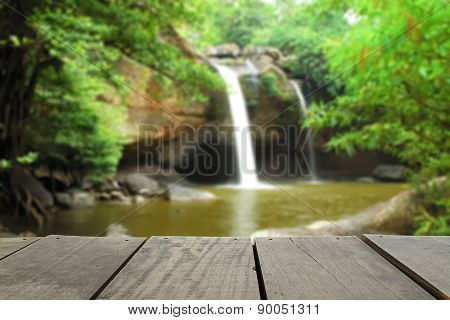 Defocused And Blur Image Of Terrace Wood And Waterfall For Backg