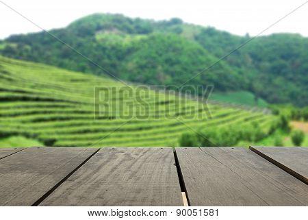 Perspective Wood Over Blur Beautiful Tea Faem And Landscape Moun