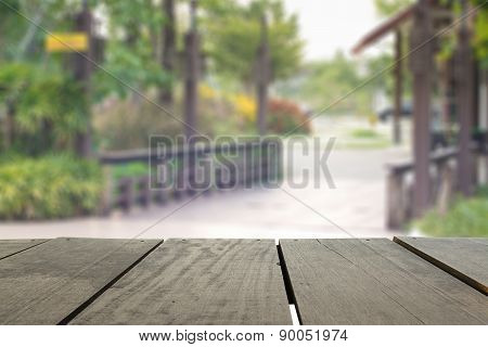 Defocused And Blur Image Of Terrace Wood And Public Park For Bac