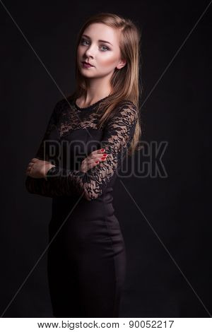 Beautiful Girl In Cocktail Dress On Black Background