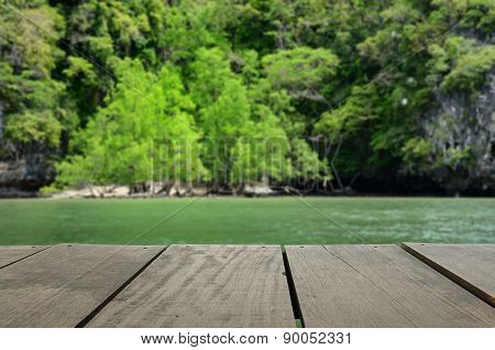 Defocus And Blur Image Of Terrace Wood And Beautiful Island In A