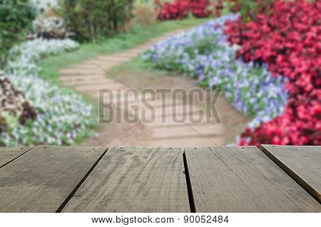 Defocused And Blur Image Of Terrace Wood And Pathway In The Park