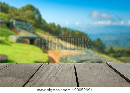Defocused And Blur Image Of Terrace Wood And Military Bunker For