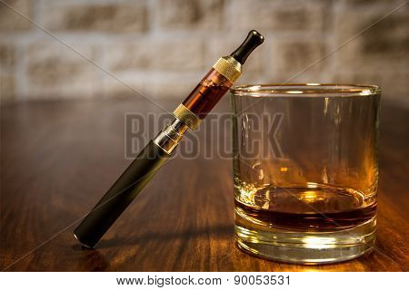 Electronic Cigarette And A Glass Of Whiskey