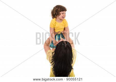 Mom Raise Child Over Head