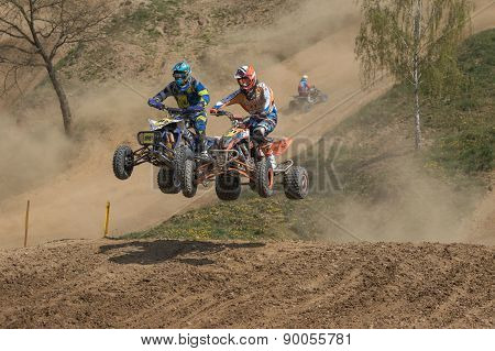 Quad Race - Duel Between Two Riders In A Jump