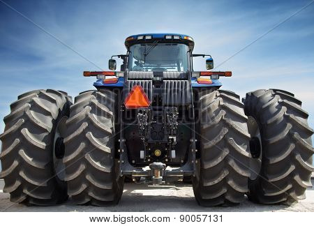 Farm Tractor On Huge Wheels