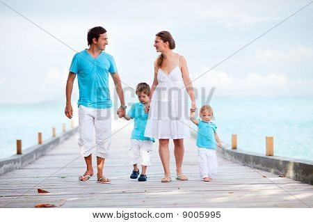 Family Walking Along Jetty