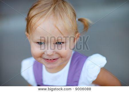 Closeup Portrait Of Adorable Playful Girl