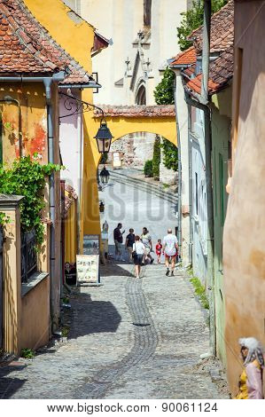 Old Stone Paved Street With Tourists From Sighisoara Fortress