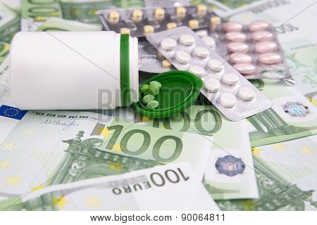 Tablets On A Background Of Money
