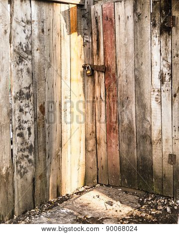Locked Wooden Door In Sunlight