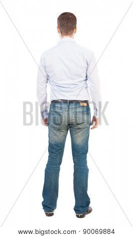 Back view of man in jeans. Standing young guy. Rear view people collection.  backside view of person.  Isolated over white background. Business man in shirt and jeans is looking ahead.
