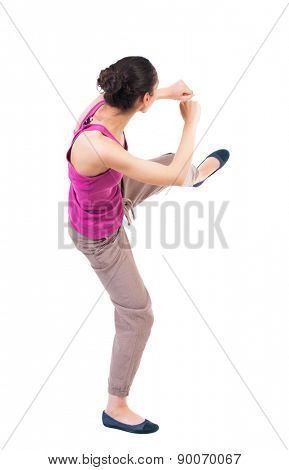 skinny woman funny fights waving his arms and legs. Rear view people collection.  backside view of person.  Isolated over white background. African American woman in sparring.