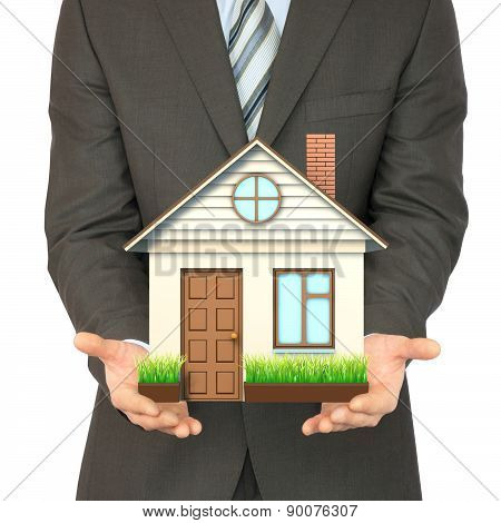 Man in suit holding house