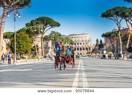 ROME, ITALY - APRIL 13, 2015: Horse carriage in front of Colosseum  on April 13, 2015 in Rome Italy. The tourists are invited to take a city tour in a horse carriage