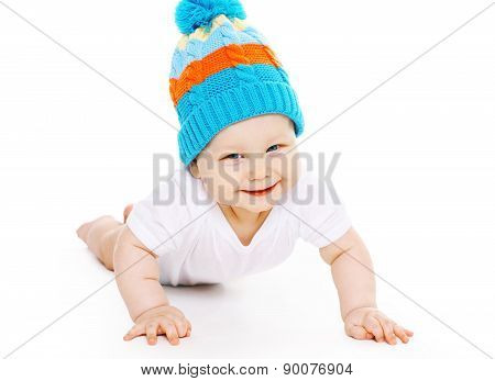 Portrait Of Cute Smiling Baby In Knitted Hat