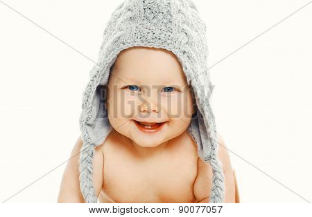 Smiling Baby In Knitted Hat Sitting On A White Background