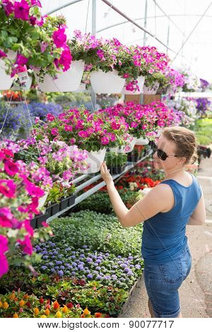 Trendy Woman Selecting Nursery Plants