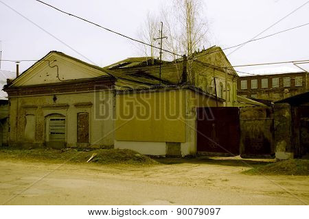 Destroyed building with boarded up windows of a bakery in the Ru