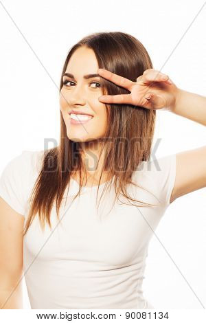 life style, happiness, emotional  and people concept: Beautiful young  woman wearing white shirt looking at camera and make different emotions while standing against white background