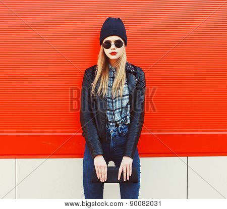 Fashion Portrait Of Blonde Girl In Rock Black Style, Wearing A Sunglasses And Leather Jacket Standin