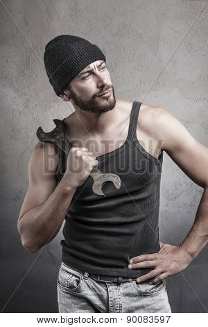 Rough Man Holding A Wrench On His Shoulder