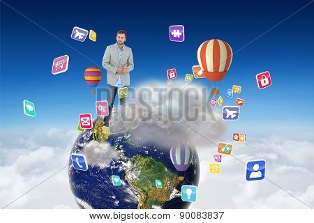 Suave man in a blazer against cloud computing graphic with hot air balloons