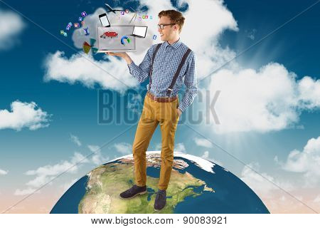 Geeky businessman showing his laptop against cloud computing graphic with apps
