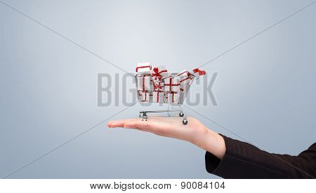 Businesswomans arm presenting against grey vignette