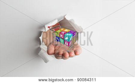 Hand presenting through paper against grey vignette