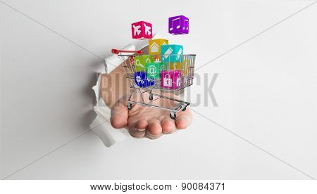 Hand presenting through paper against white background with vignette