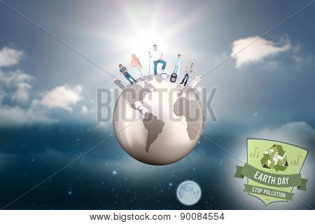 People standing on the world against sky