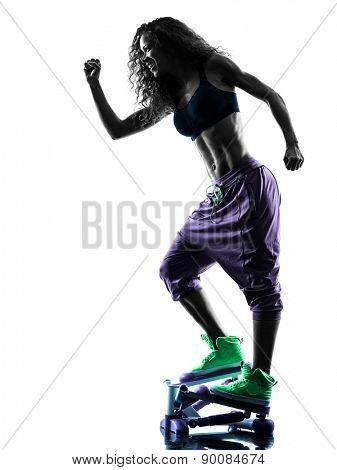 one african woman exercising Stepper fitness exercises in studio silhouette isolated on white background