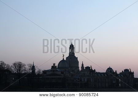 Sunset over domes of the Church of Our Lady (Frauenkirche) and the Academy of Fine Arts in Dresden, Saxony, Germany.