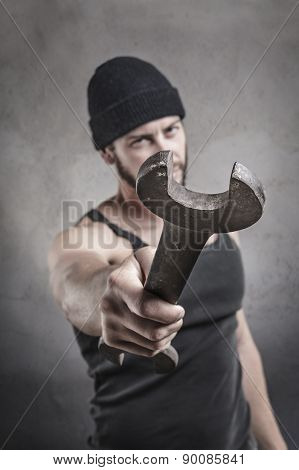 Aggressive Man Using A Wrench As A Weapon