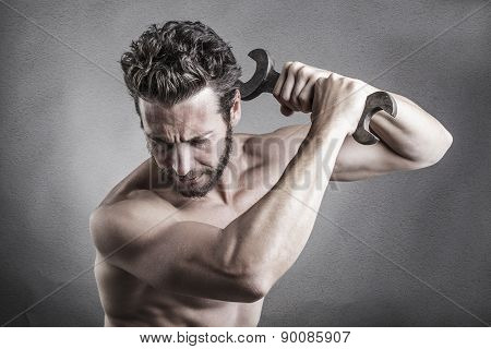 Bare Chest Man Using A Spanner Or Wrench As A Weapon