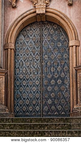 Ornamental Cathedral Door set in Brown Stone
