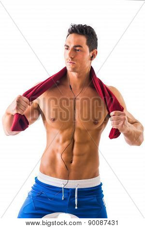 Handsome power athletic guy listening to music